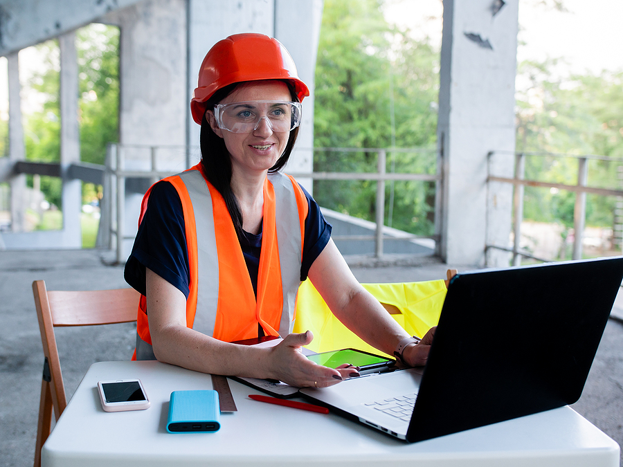 Female worker using construction ERP software solution