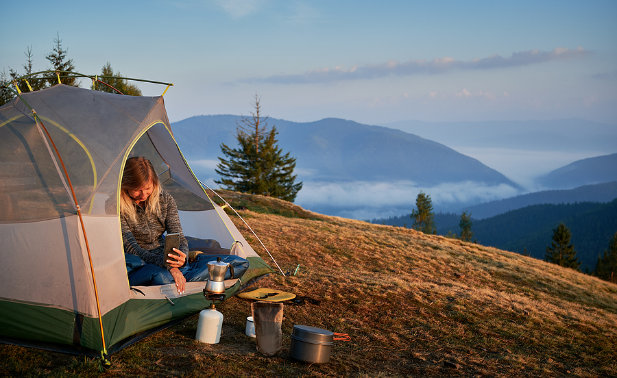 Woman using camping hire equipment