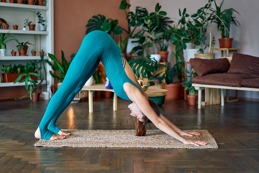 Young Woman Taking Online Yoga Courses