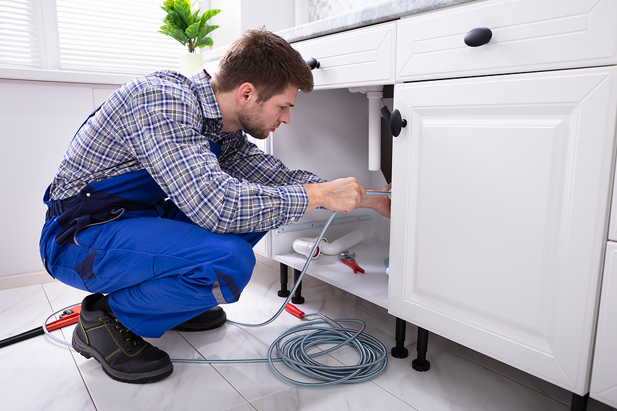 Canberra plumber cleaning a clogged sink