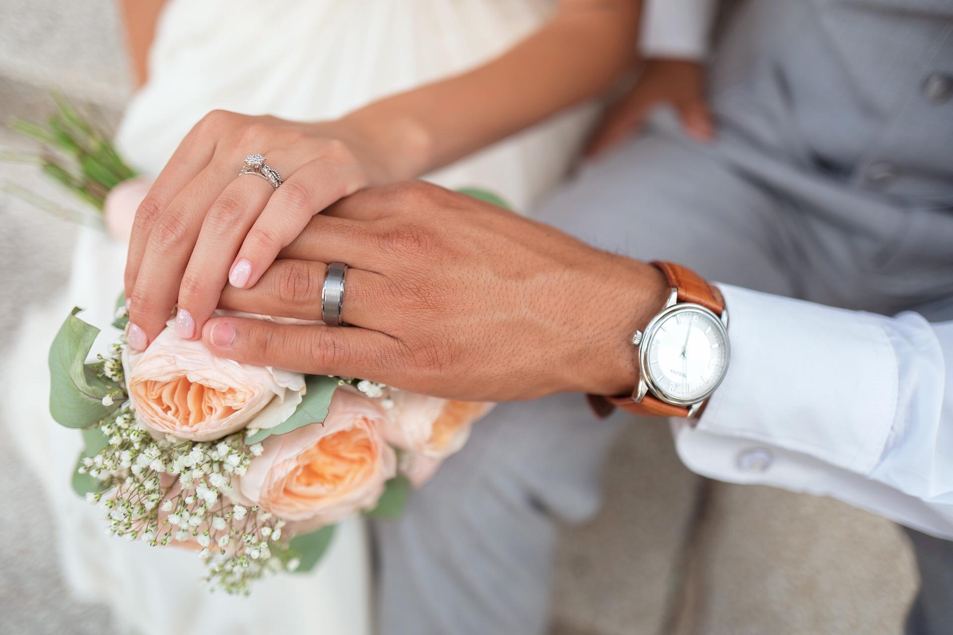 Couple wearing wedding rings in Brisbane